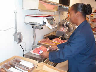 Picture of inspector checking pre-packaged meat.