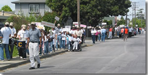 Photo of a group of people rallying on street.