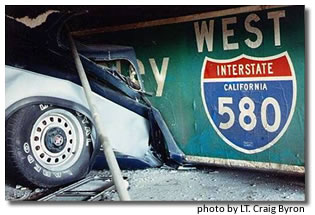 car crushed by sign