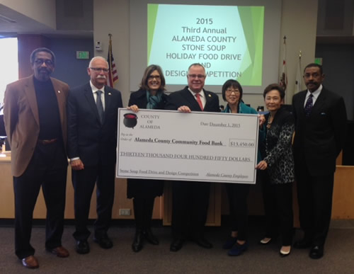Board of Supervisors presenting donation check to Alameda County Food Bank Executive Director, Suzan Bateson