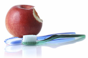 an apple and toothbrush