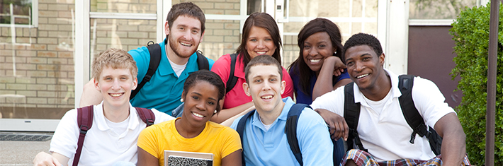 Photograph of seven highschool/college age kids with backpacks on