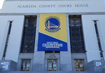 photo of Rene C. Davidson Courthouse with the Warriors Championship Banners