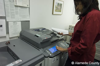 Photo of employee selecting 2 sided copies.