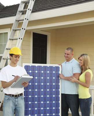 Photo of homeowners having a solar panel installed on their house.
