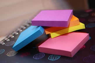 small, brightly colored post-it notepads. credit: Taking Notes by venspired, on Flickr