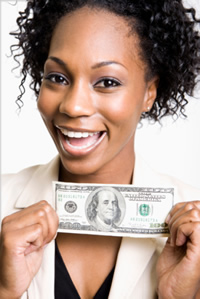 woman holding money and smiling