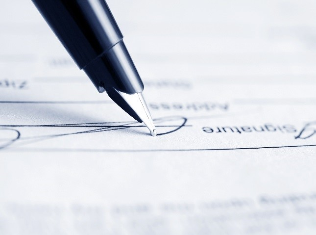 image of pen signing document