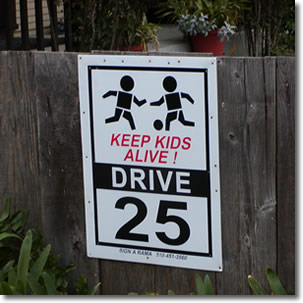 Photo of a sign warning drivers to slow down for children playing.