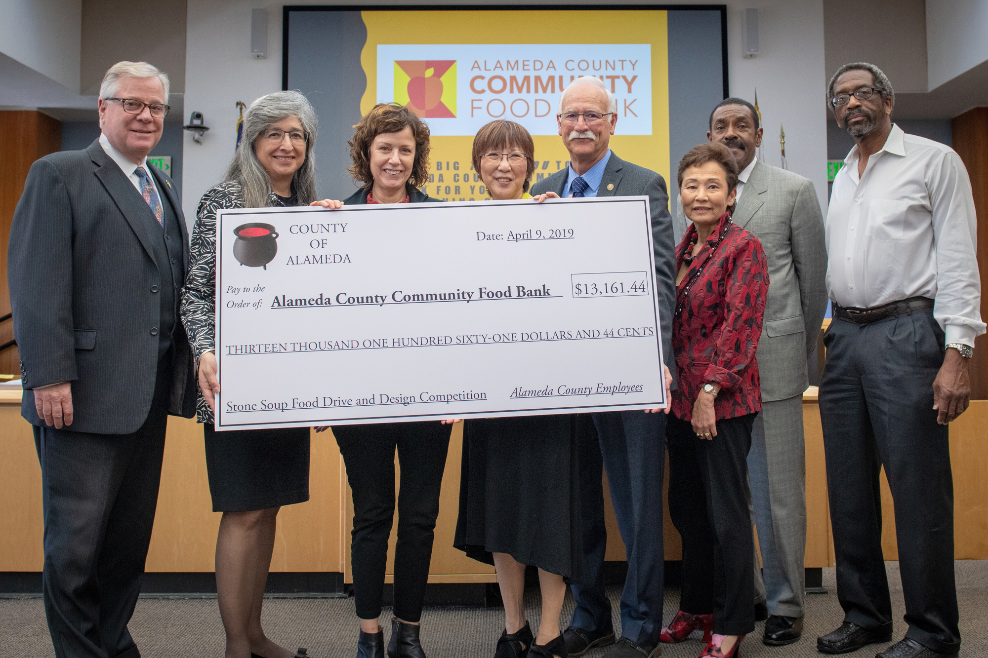 Our Board of Supervisors and County Administrator presented Alameda County Community Food Bank with a $13,161 check to culminate the Stone Soup Food Drive.