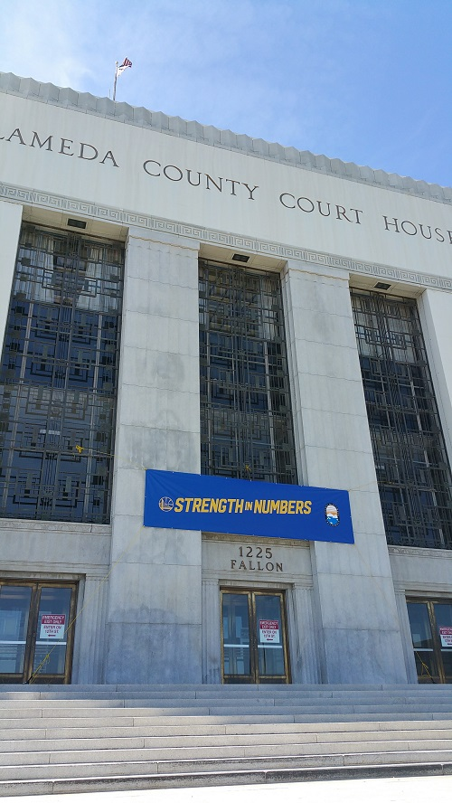 Photograph of County Buildings with banners and lights depicting support for the Golden State Warriors