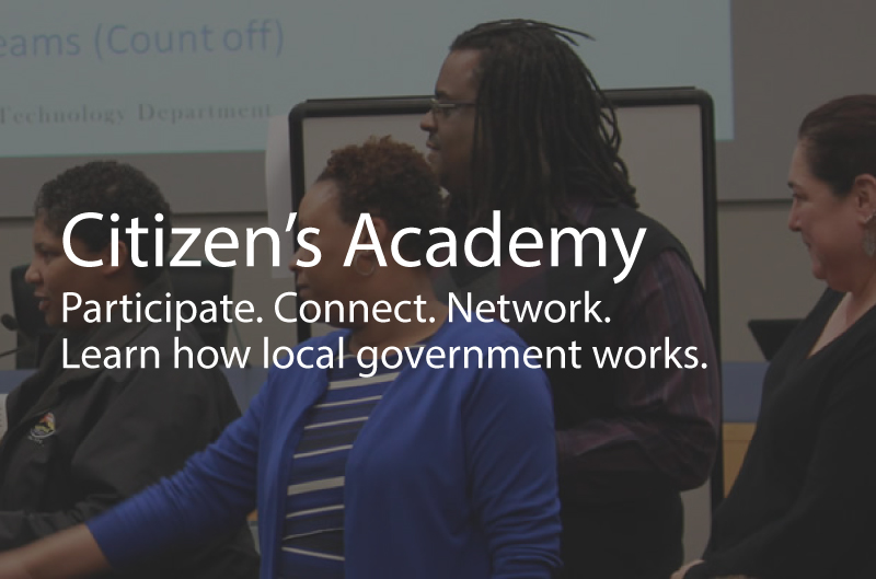 Photo showing people at the citizens academy. Caption: Citizen's Academy. Participate. Connect. Network. Learn how local government works.